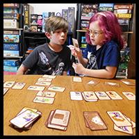Geeklings inspect the treasure cards
